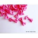 Mini ribbon bow with polka dots - Hot pink