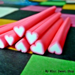 Pink heart polymer clay cane